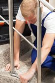 Repairman working on staircase — Stock Photo