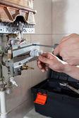 Tightening bolt on water heater — Stock Photo