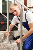 Worker tightening stairs — Stock Photo