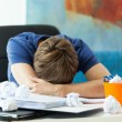 Student sleeping on table — Stock Photo #51539375