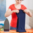 Woman folding clothes — Stock Photo #51647275