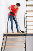 Housekeeper during hoovering — Stock Photo
