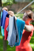 Woman hanging clothes — Stock Photo