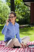 Woman talks on phone — Stock Photo