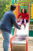 Dad and daughter on playground — Stock Photo