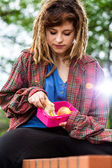 Girl with lunch box — Stock Photo