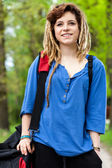 Smiling girl with travel bag — Stock Photo