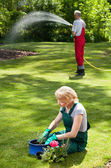 Couple during everyday duties in garden — Stock Photo