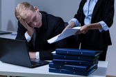 Tired man working overtime — Stock Photo