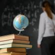 Stock Photo: School still life with books and blackboard