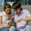 Two students using tablet — Stock Photo