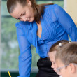 Teacher helping little schoolgirl — Stock Photo