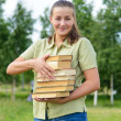 Weight of knoledge: university student girl with heavy load of b — Foto de stock #27349021