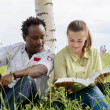 Two students reading a big book — Stock Photo