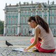 Young female tourist studying map — Stock Photo