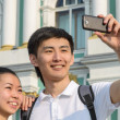 Tourists taking self-portrait pictures — Stock Photo