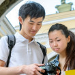 Young asian tourists taking pictures — Stock Photo