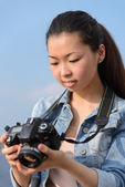 Female tourist taking pictures in city — Stock Photo