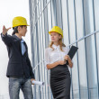 Two young architects on construction site — Stock Photo #30826319
