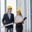 Two young architects on construction site — Stock Photo