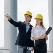 Two young architects on construction site — Stock Photo #30826417