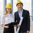 Architects team on construction site — Stock Photo