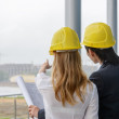 Two young architects on construction site — Stockfoto
