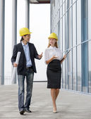Two young architects walking on construction site — Stock Photo