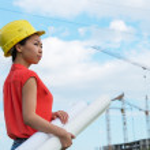 Asian female designer on construction site. — Stock Photo