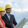 Business team of architects on construction site. — Stock Photo