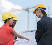 International business team on construction site. — Stock Photo