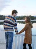 Happy romantic couple holding hands — Stock Photo
