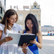 Portrait of two student girls with notes outside — Stock Photo