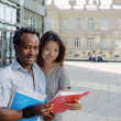 Two students reading notes outside — Stock Photo