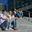 Two students sitting on steps outside university — Stock Photo
