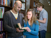 International students in a library — Stock Photo