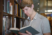 Male student in a library — Stock Photo