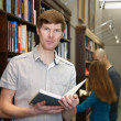 Male student in a library — Stock Photo #41920091