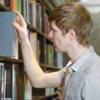 Male student in a library — Stock Photo #41920221