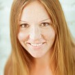 Adorable red-haired smiling young woman — Stock Photo