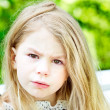 Adorable blond crying little girl with tears on her cheeks — Stock Photo