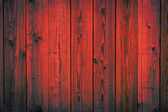 Red painted wooden peeling off planks, texture background — Stock Photo