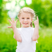 Beautiful blond little girl showing six fingers (her age) and smiling — Stock Photo