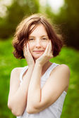 Closeup portrait of an adorable young woman with curly hair in summer forest, field — Stock Photo
