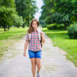 Beautiful teenager girl in casual clothes going to school on sunny september day, outdoor portrait — Stock Photo