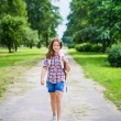 Pretty teenager girl in casual clothes going to school on sunny september day, outdoor portrait — Stock Photo