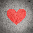 Painted red heart on dark grey grunge concrete and cement wall, textured background — Stock Photo