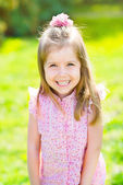Adorable laughing little girl with long blond hair, outdoor portrait in summer park — Stock Photo