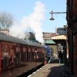 Steam train  on platform — Stock Photo