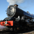 Steam train engine on platform — Stock Photo #24719939